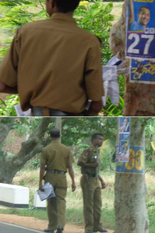 Police officers replacing Dayasiri's posters with Johan's - CaFFE