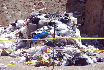 Infant's body found among trash