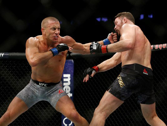GSP beats Bisping on return to become two-weight champ