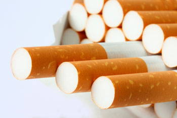 Chinese national arrested with 155  cigarette cartons
