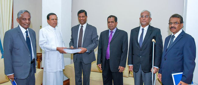 Bond commission hands over report to President Sirisena