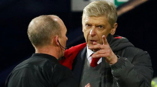 Wenger gets touchline ban after admitting 'abusive' behaviour