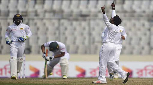 Lankans secure 215 run victory over dismal Bangladesh