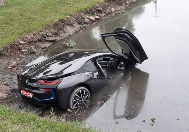 Suspect Surrenders Over Bmw Sports Car Accident