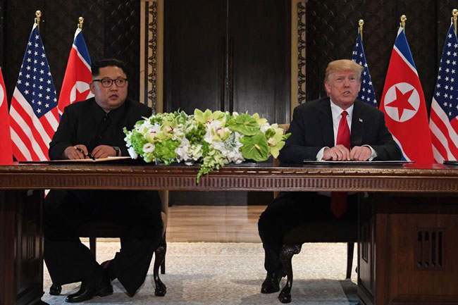 Trump and Kim sign agreement following historic meeting in Singapore