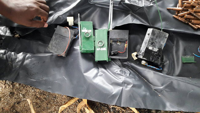 Two nabbed with LTTE uniforms, flags and claymore explosives