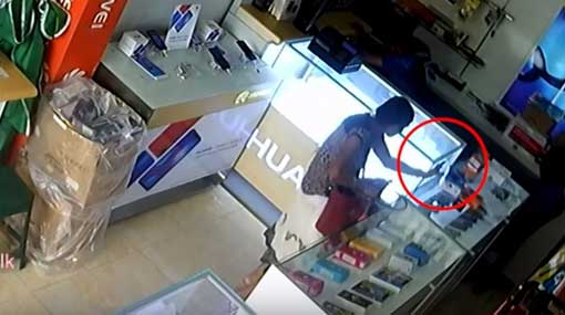 CCTV: Woman getting phone repaired steals new phone from store