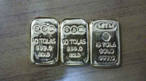 Businessman held with gold biscuits worth over Rs 2.4m