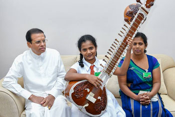 President gifts Sitar to student...