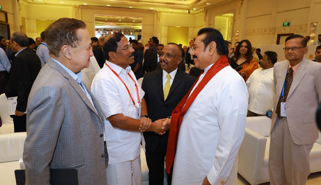 Mahinda attends second day of 'The Huddle' in India