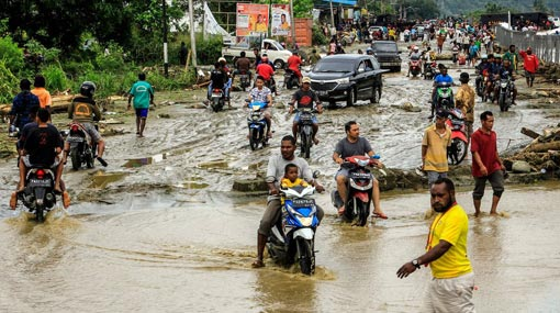Flash flooding in Indonesia kills at least 50