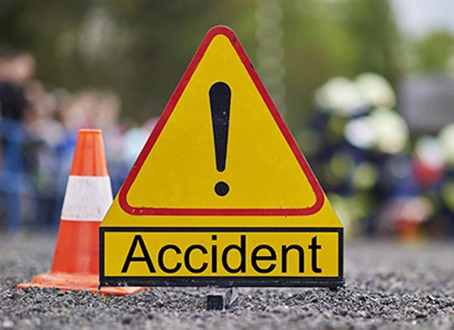 One dead, twenty-two injured in bus accident