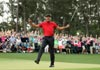 Tiger Woods wins Masters to claim first major in 11 years
