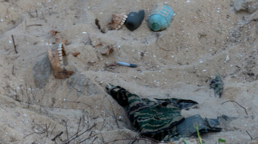 Bone fragments & parts of LTTE uniforms found at Vellamullivaikal