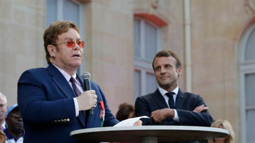 Elton John gets top French award, joins AIDS fight call