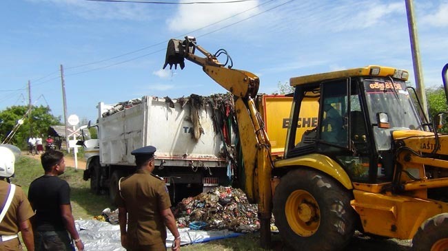 Two tippers carrying Colombo garbage to Aruwakkalu collide with each other