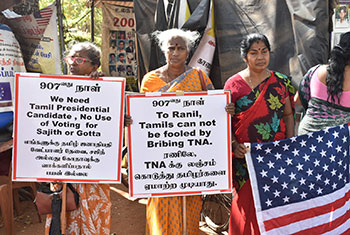 Families of disappeared protest during PM's visit....