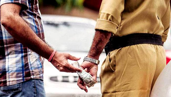 Man arrested attempting to bribe cop