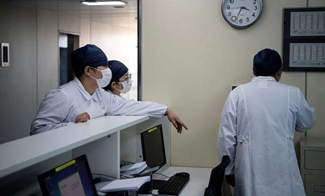Wuhan hospital director dies of COVID-19 while death toll rises to 1,868