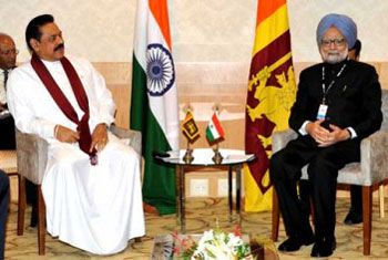Rajapaksa and  Singh discuss rehabilitation, devolution