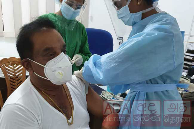 C. B. Ratnayake receives COVID-19 vaccine