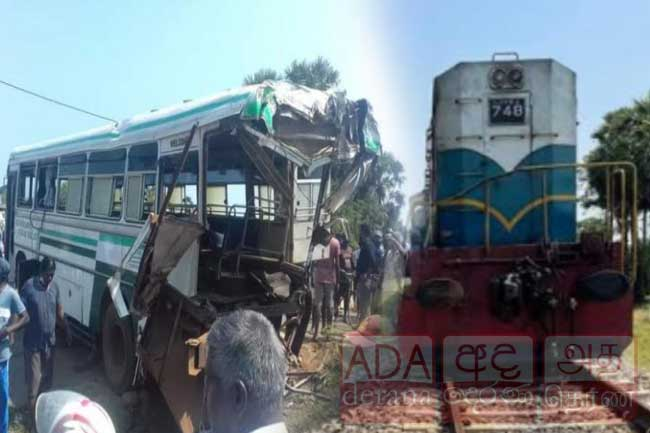 One dead, several injured as train hits bus in Talaimannar