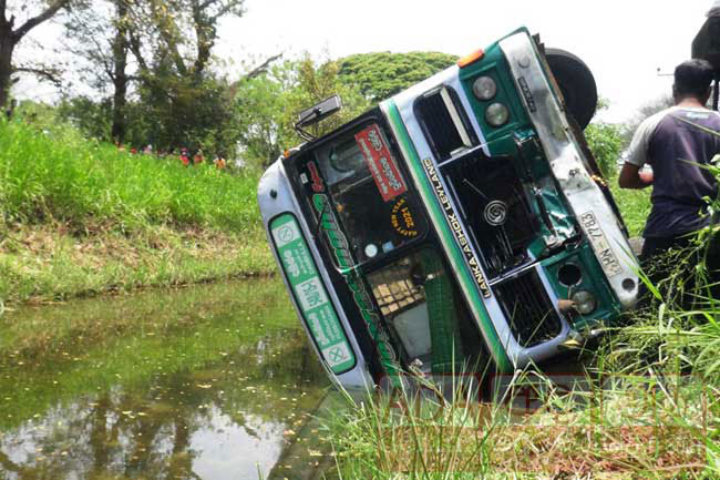 Eighteen injured as bus topples into canal