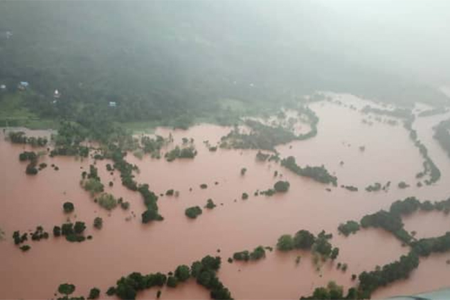 At least 125 dead as heavy rain in India triggers floods, landslides