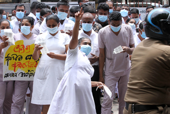 Health workers launch token strike...