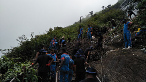 Mahagiri damba landslides: armed forces assist clearing of garbage heap